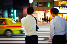 2 Men Are Waiting The Red Sign To Crossing The Road.