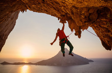 Male Rock Climber Hanging On C...