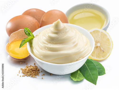 Mayonnaise sauce in white bowl with mayonnaise ingredients.