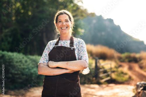 Obraz na płótnie Proud farmer at her countryside home