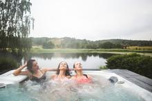 Female Friends Enjoying In Hot...
