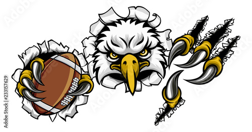 An eagle bird American football sports mascot cartoon character ripping through Fototapet
