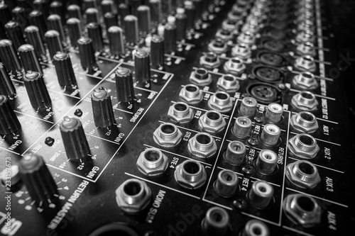 Fotografie, Obraz  Closeup Professional Audio Mixing Console Inputs and Outputs