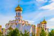 Leinwanddruck Bild - Gold domes of Temple of Archangel Michael on background of blue sky. Minsk, Belarus