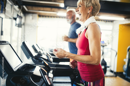 Staande foto Wanddecoratie met eigen foto Senior people running in machine treadmill at fitness gym club