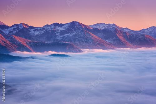 Foto auf Gartenposter Gebirge Amazing sunset in Alps mountains over cloud and mountain ridge in sunlight, Hohe Tauern national park, Carinthia, Austria