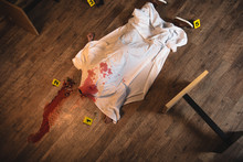 Top View Dead Body Covered With White Sheet At Crime Scene