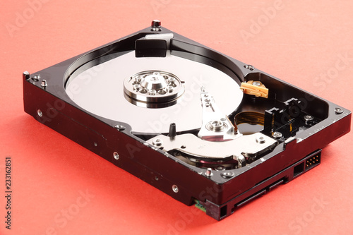 Fotografia  Hard disk drive (HDD) isolated on orange background