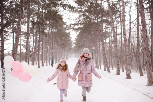 Happy Sister Girls Running In Park Holding Balloons At Winter Time Lo Ng At Camera Childhood