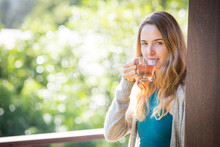 Young Woman Drinking Herbal Tea Outdoors