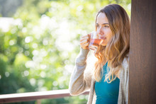 Young Woman Drinking Herbal Te...