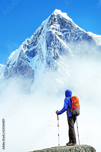 Fototapeta Hiker with backpacks reaches the summit of mountain peak. Success, freedom and happiness, achievement in mountains. Active sport concept. obraz