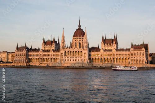 Fotografie, Obraz  Budapest parliament building at sunset golden time with blue and Danube river