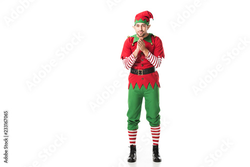 Leinwand Poster excited man in christmas elf costume looking at camera and rubbing hands in anti