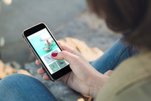 Woman Touch The Screen Of Her Smartphone With Dental Clinic Website