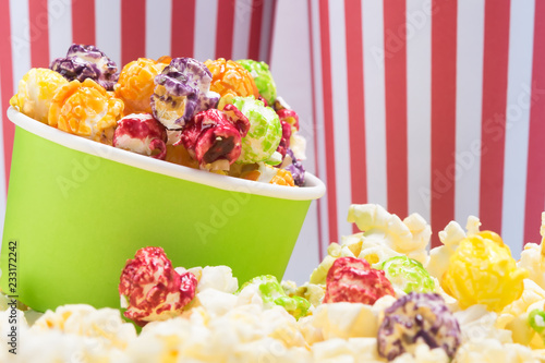 Fotobehang Buffet, Bar paper cup with multicolored sweet popcorn, beautiful background for an inscription