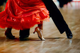 dance sports couple red dress black suit tail