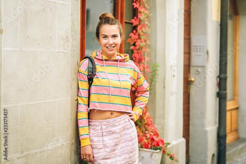 Photographie  Portrait of young beautiful woman wearing stripe sweatshirt