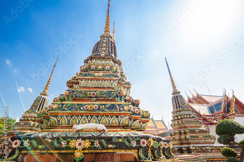 Beautiful Buddhist temple Wat Pho in the capital of Thailand Bangkok against the blue sky, bright colors, sights, a trip to Asia, the culture and architecture of Southeast Asia