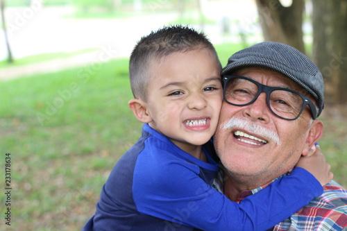 Fotografie, Obraz  Grandfather having a fun with his grandson