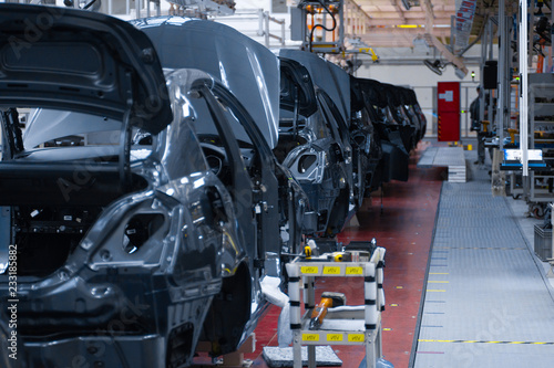 Canvas Prints Art Studio Movement of vehicles along the production line at the plant. Car Assembly shop. Car Assembly by parts