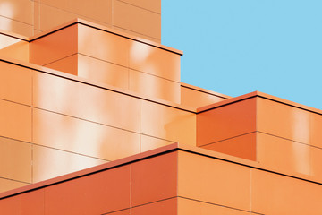 Modern building facade detail, abstract architectural metal shape against blue sky
