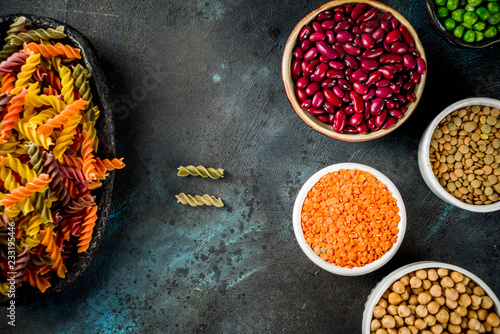 Printed kitchen splashbacks Spices Trend healthy food, vegan diet concept. Multi colored legume pasta with raw beans. Beans, chickpeas, green peas, lentils. Copy space top view