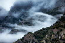 Moody Mountains And Clouds Wit...
