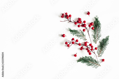 Spoed Fotobehang Kerstmis Christmas composition. Pattern made of fir tree branches and red berries on white background. Christmas, winter, new, year, nature concept. Flat lay, top view, copy space