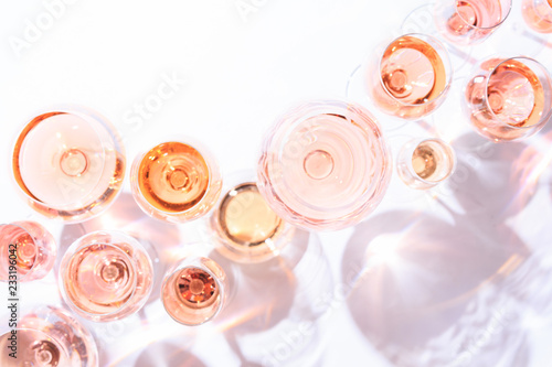 Foto auf Gartenposter Roses Many glasses of rose wine at wine tasting. Concept of rose wine and variety