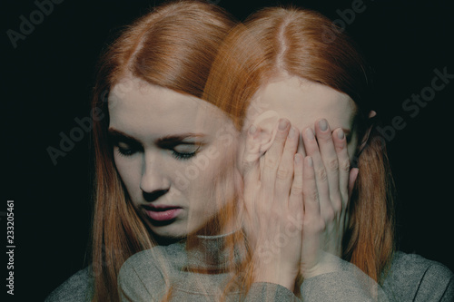 Porter of beautiful redhead girl with psychotic disorders covering her face, hid Slika na platnu