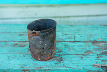 Corroded Metal Can On Blue Wooden Boards