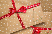 Kraft Envelope In White Polka Dots With Red Ribbon. New Year Gift. Copy Space