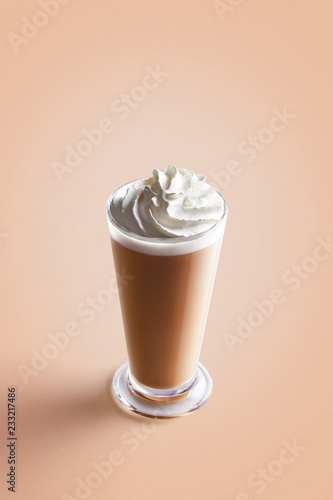 Fotografie, Obraz  Large cappuccino coffee in transparent mug with cream on a colorful background