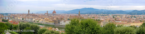 Fotobehang Florence Panorama of Florence, Italy, showing the skyline with churches, cathedrals and palaces, the river San Lorenzo and the bridge on a cloudy summer day, seen from high above