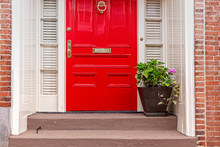 Red Door And Potted Plant On ...