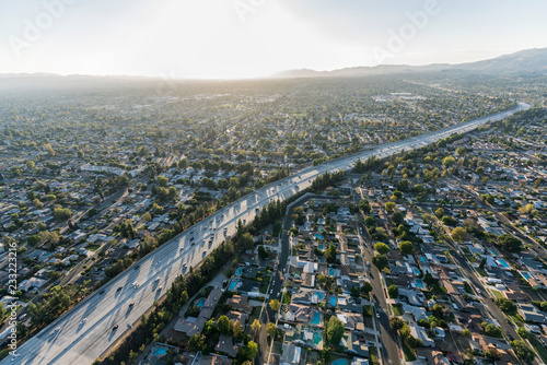 Late afternoon aerial view above the Route 118 freeway in the San Fernando Valley area of Los Angeles, California.