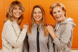 canvas print picture - Three happy mature woman with different age together