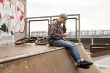 Man Listening To Music In Skatepark