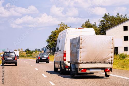 Fotografiet Mini van with Car trailer on roadway in Poland