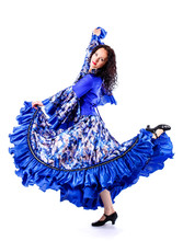 A Girl In A Colorful Dress Dances A Gypsy Dance.