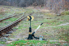 Old Rusty Railway Arrow To Move The Rail In The Right Direction