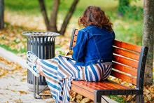 Woman Sitting On Bench In Park At Novodevichy Pond Moscow
