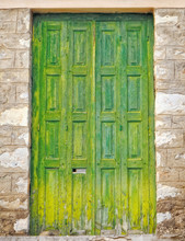 Greece, Wooden Green Door Of Traditional Stone House