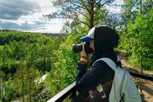 Girl Taking Photos Of Ruskeala Marble Canyon In Karelia