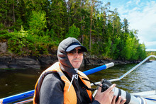 Man Taking Photos On Ladoga Lake In Karelia