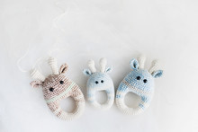 Simple Knitted Baby Toys On White Background.