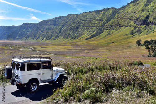 Adventurous jeep tour around the Mount Bromo in sunny day, Java Island, Indonesia
