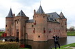 The Muiderslot or Castle of Muiden, the famous medieval castle in Netherlands. A tourist is taking pictures.