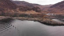 Aerial Drone Shot Of Small Boat Moored Nearby The Black Cuillin And Loch Coruisk On Isle Of Skye, Scotland